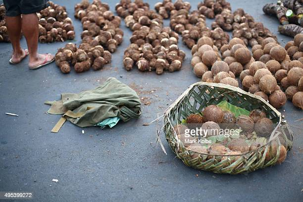 A local vendor stands in his stall selling coconuts and taro at the Apia fruit and vegetable market on September 13 2015 in Apia Samoa