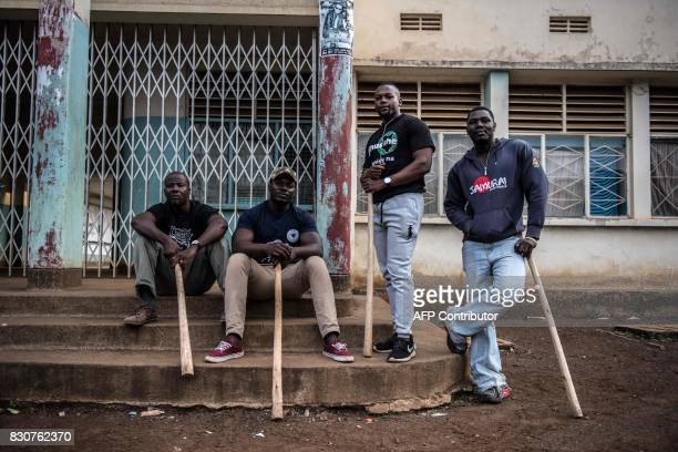 A local vigilante group of bouncers and bodyguards pose on August 12 2017 in Kisumi following presidential electionrelated violence to protect small...