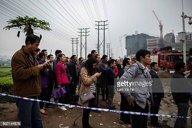 Local villagers await for news of the missing victims after a landslide destroyed or damaged more than 30 buildings on December 21 2015 in Shenzhen...