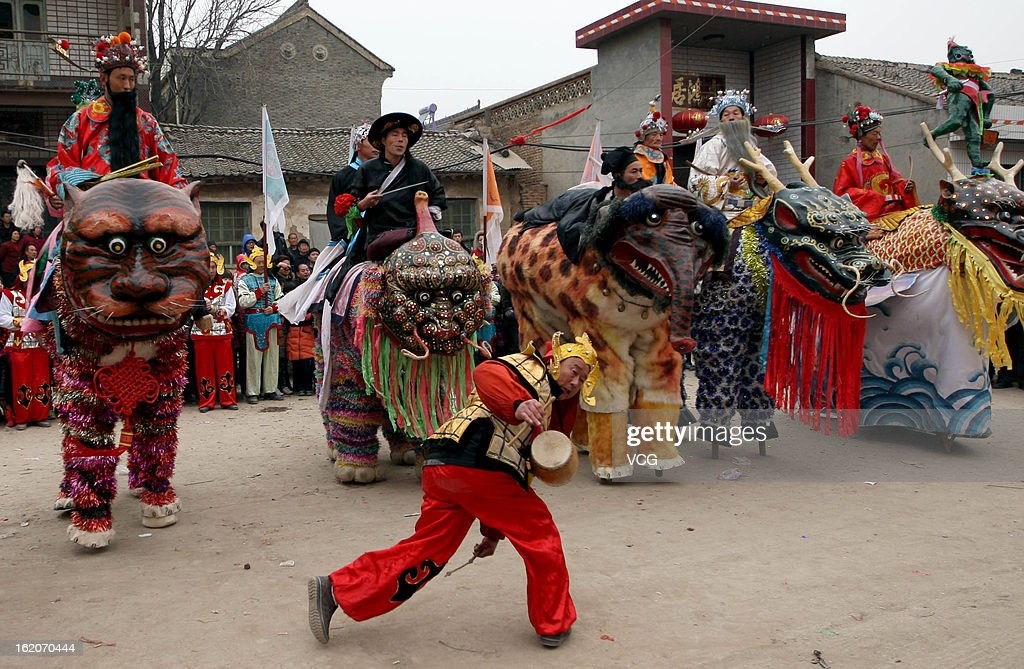 Local villagers perform a stilt dance to celebrate the Spring Festival on February 18, 2013 in Jishan County, China. The Chinese Lunar New Year also known as the Spring Festival, which is based on the Lunisolar Chinese calendar, is celebrated from the first day of the first month of the lunar year and ends with Lantern Festival on the Fifteenth day. 2013 is the Year of the Snake according the 12-year cycle of animals which appear in the Chinese Zodiac.