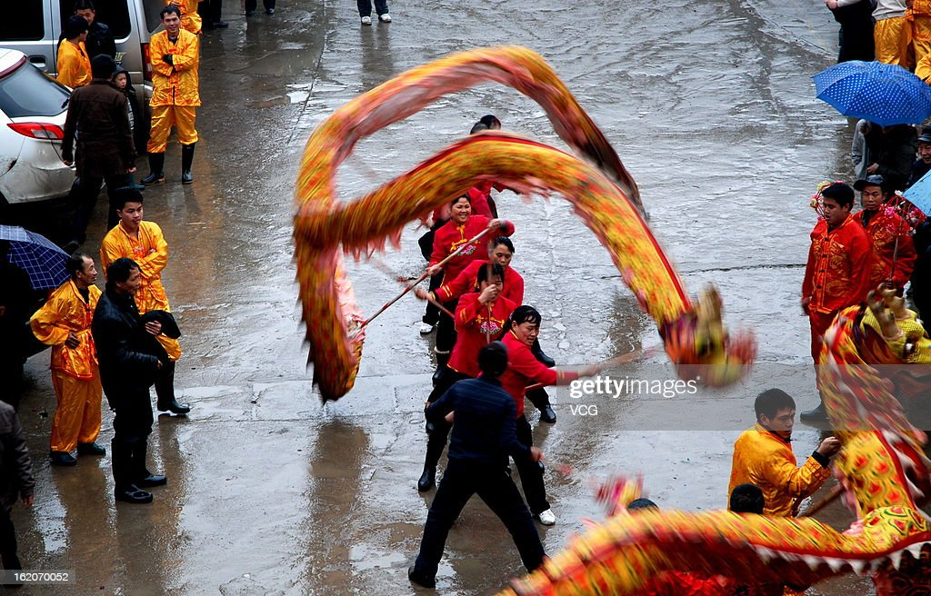 Local villagers take part in a dragon dance to celebrate the Spring Festival on February 18, 2013 in Quanzhou County, China. The Chinese Lunar New Year also known as the Spring Festival, which is based on the Lunisolar Chinese calendar, is celebrated from the first day of the first month of the lunar year and ends with Lantern Festival on the Fifteenth day. 2013 is the Year of the Snake according the 12-year cycle of animals which appear in the Chinese Zodiac.