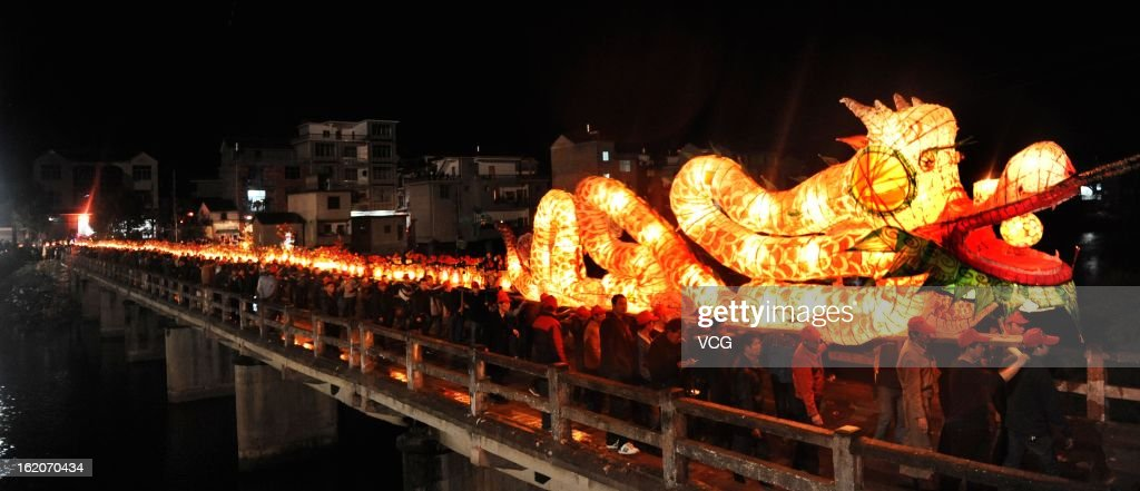 Local villagers take part in a dragon dance to celebrate the Spring Festival on February 18, 2013 in Dexing, China. The Chinese Lunar New Year also known as the Spring Festival, which is based on the Lunisolar Chinese calendar, is celebrated from the first day of the first month of the lunar year and ends with Lantern Festival on the Fifteenth day. 2013 is the Year of the Snake according the 12-year cycle of animals which appear in the Chinese Zodiac.