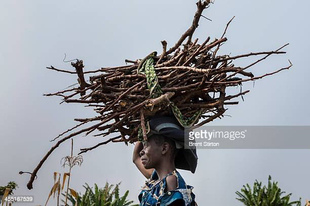 Local villagers with firewood and roofing grass from the forest in the West Lake Edward village of Lunyesenge on July 29 2013 in DR Congo Villagers...