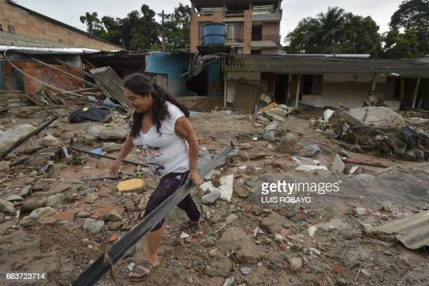 A local walks amid rubble left by mudslides following heavy rains in Mocoa Putumayo department southern Colombia on April 2 2017 The death toll from...
