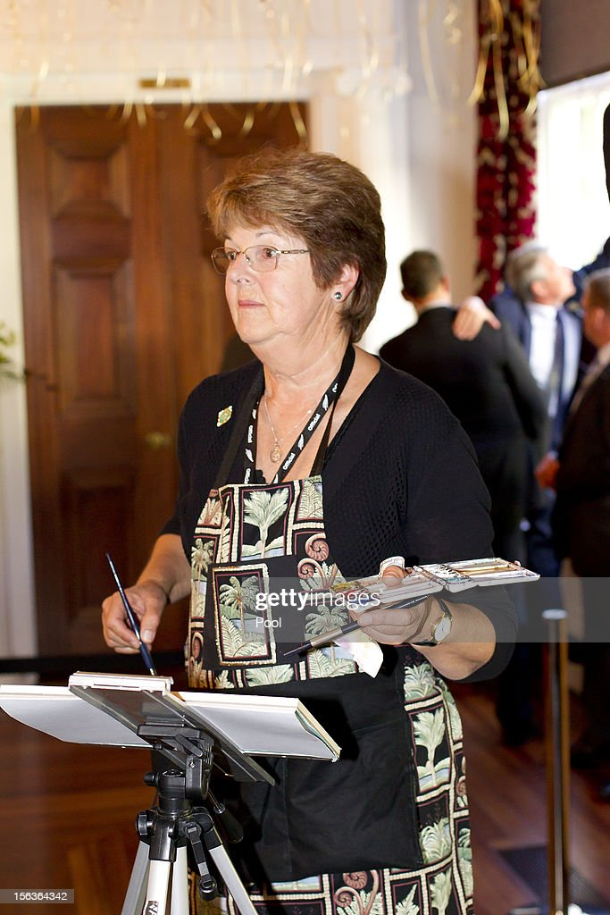 Local watercolour artist Sue Wild paints as Prince Charles, Prince of Wales (not pictured) celebrates his 64th birthday at Government House on November 14, 2012 in Wellington, New Zealand. The Royal couple are in New Zealand on the last leg of a Diamond Jubilee that takes in Papua New Guinea, Australia and New Zealand.
