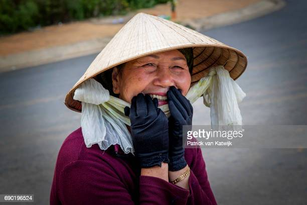Local well wishers during the visit of Queen Maxima of the Netherlands at a grocery store that offers banking services of the Lien Viet Post Bank on...