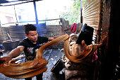 A Local whipping cooled Raw Hard boiled molasses to molasses Chaku on 06 January 2015 at Tokha Kathmandu Nepal for the celebration of Maghe Sankranti...