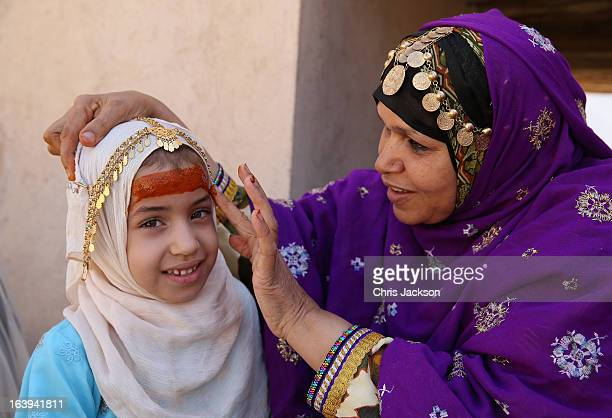 A local woman and her daughter in traditional dress as Prince Charles Prince of Wales and Camilla Duchess of Cornwall visit Nizwa Fort on the eighth...