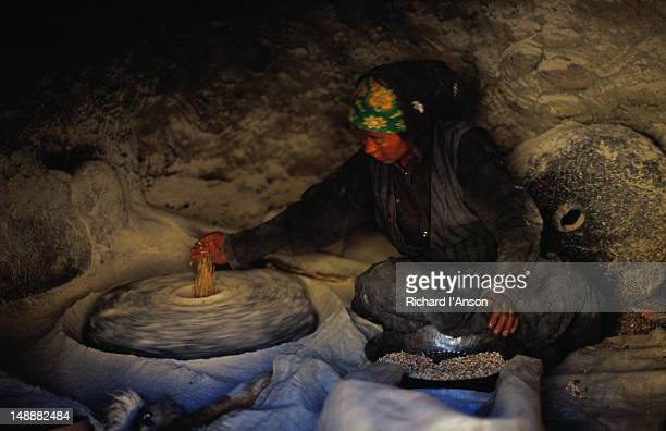 Local woman from Charang milling buckwheat using a water wheel.