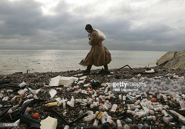 A local woman removes cargo from Branscombe beach near the stricken cargo ship MSC Napoli on January 22 2007 in England Salvage experts are trying to...