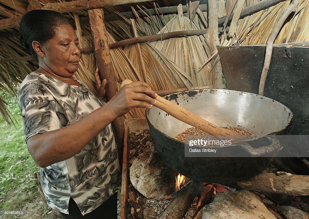 Local woman roasting coffee beans