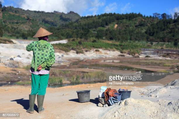 Local woman selling in Dieng Plateau, Central Java, Indonesia