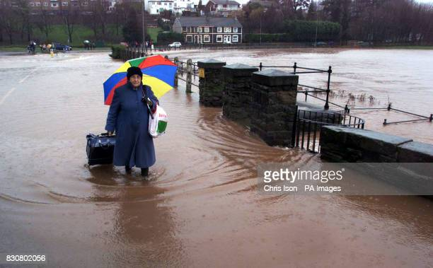 A local woman trudges home across the River Usk which burst its banks in Abergavenny Wales The Environment Agency Wales confirmed three severe...