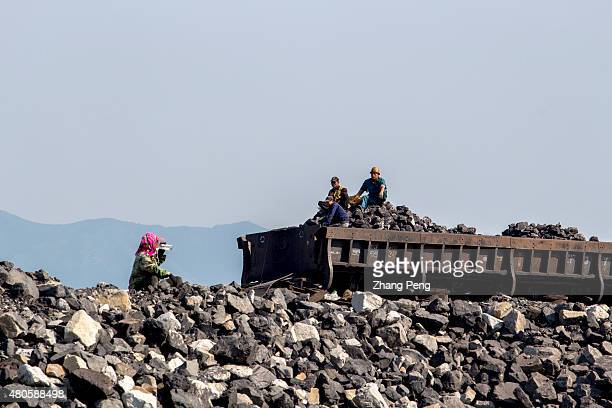 Local women are extracting coal from mineral residues dumped from the steam train Fuxin located in China's northeast Liaoning Province which had the...