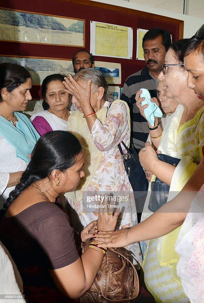Local women console Savita, mother of Akhil who was victim of Beas river tragedy on June 12, 2014 in Mandi, India. Two more bodies were recovered from the river. A wall of water washed away 24 engineering students and a tour operator Sunday evening after water was released into the river allegedly without a warning from a nearby Pandoh Dam on Beas River.