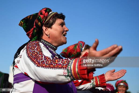 Local women in traditional Mordovskoe dress dance and sing during a media tour of Russia 2018 FIFA World Cup venues on July 17 2015 in Saransk Russia