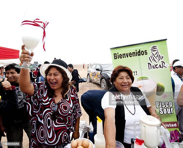 Local women prepare the national cocktail of Peru pisco sour during the 2012 Dakar Rally's Stage 11 in Tacna Peru on January 12 2012 AFP PHOTO/MARTIN...