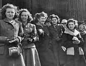 Local workers gather to watch bands of HM Guards play an outdoor concert of regimental music outside St Paul's Cathedral London 25th April 1942...