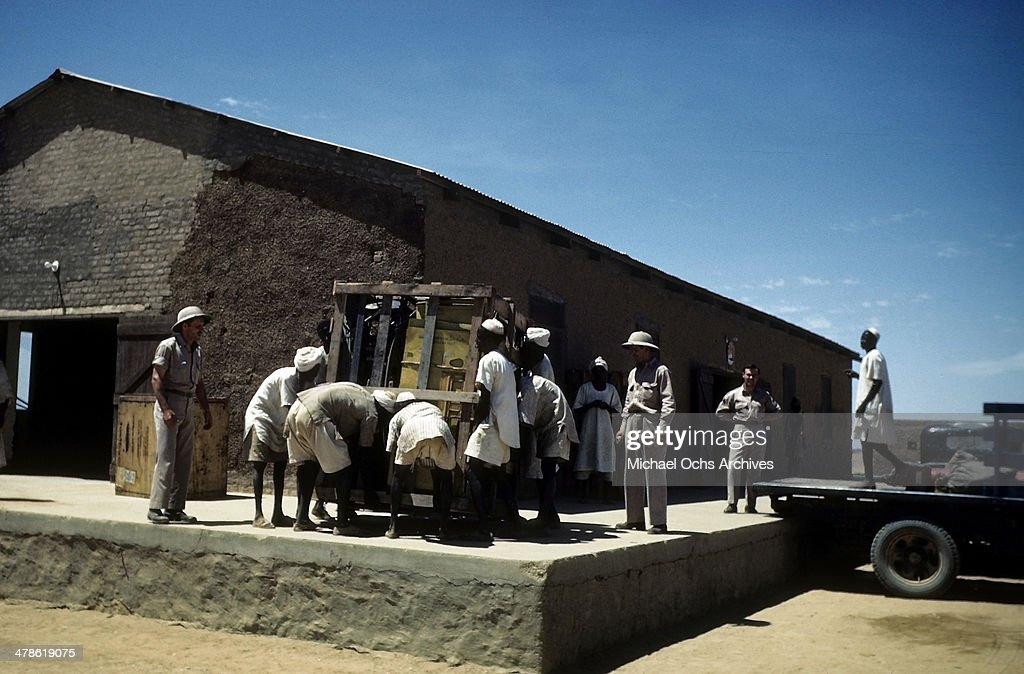 Local workers work at the Wadi Seidna air strip at the US Army Air Force/Royal Air Force base in Khartoum AngloEgyptian Sudan