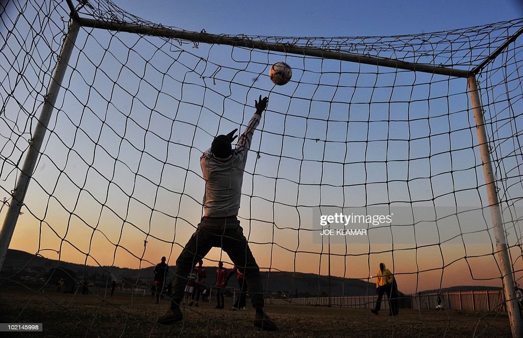 Local young man play soccer at Mamelodi township in Pretoria on June 16, 2010 during the 2010 World Cup football tournament in South Africa.