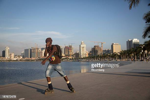 A local youth rollerblades along the promenade in Luanda Angola on Friday Nov 8 2013 Angola the largest crude oil producer in Africa after Nigeria...