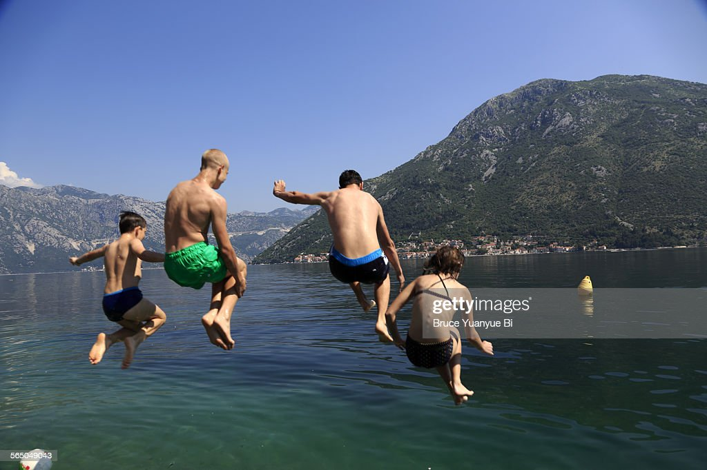 Local youths diving into Kotor Bay