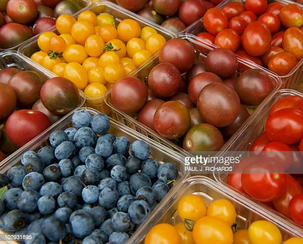 Locally grown fruits and vegetables are sold at the Herndon Virginia Farmer's Market July 30 2009 AFP Photo/Paul J Richards