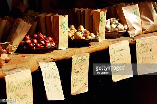 Locally grown garlic onions and kumara are displayed for sale at the Matakana Famers Market in Matakana October 11 2008 near Auckland New Zealand...