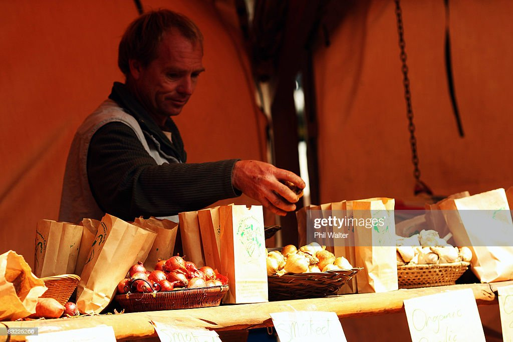 Locally grown garlic, onions and kumara are displayed for sale at the Matakana Famers Market in Matakana October 11, 2008 near Auckland, New Zealand. Farmers markets in New Zealand are rapidly growing in popularity as people seek more healthy, fresh and nutritious alternatives to supermarket food.