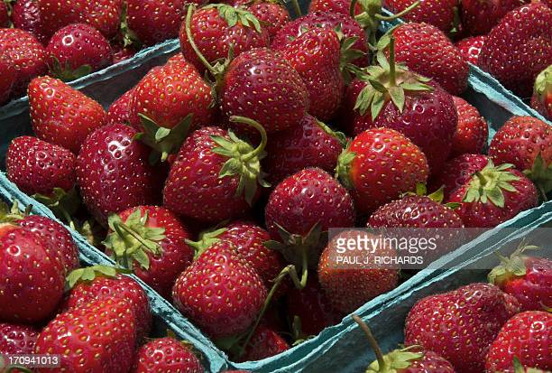 Locally grown strawberries are seen for sale at a Farmer's Market June 20 in Washington DC AFP Photo/Paul J Richards