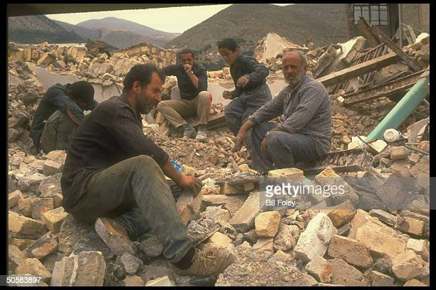 Locals amid rubble in earthquake devastated town in Gilan province