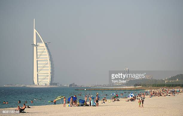 Locals and expats join holiday makers as they relax on the beach with Burj Al Arab in the background ahead of Eid AlAdha on September 11 2016 in...