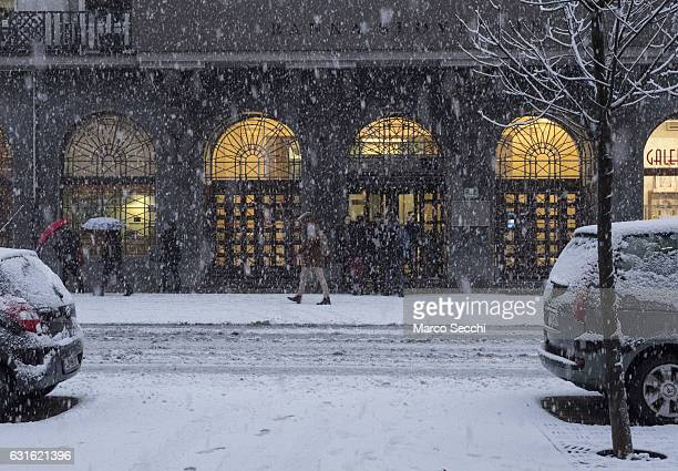Locals and member of staff walk in front of the Banka Slovenije on January 13 2017 in Ljubljana Slovenia Most of Slovenia was covered by heavy...
