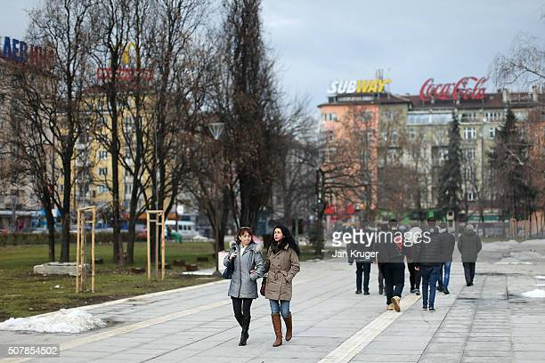 Locals and tourist walk through the grounds of the National Palace of Culture on January 31 2016 in Sofia Bulgaria