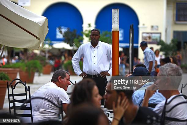 Locals and tourists fill the tables at the Factoria Plaza Vieja microbrewery and restaurant on December 22 2015 in Havana Cuba The joint...