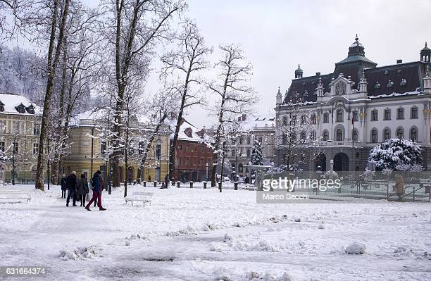 Locals and tourists walk in Congress Square on January 14 2017 in Ljubljana Slovenia Most of Slovenia was covered by heavy snowfalls for the first...