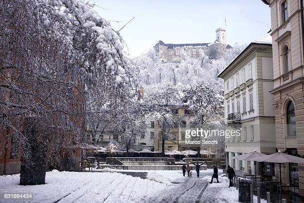 Locals and tourists walk in Congress Square with the background of the Castle on January 14 2017 in Ljubljana Slovenia Most of Slovenia was covered...