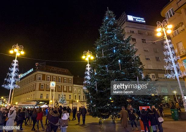 Locals and tourists walk past the Christmas tree in the main square on December 22 2015 in Zagreb Croatia Zagreb was voted last week European...
