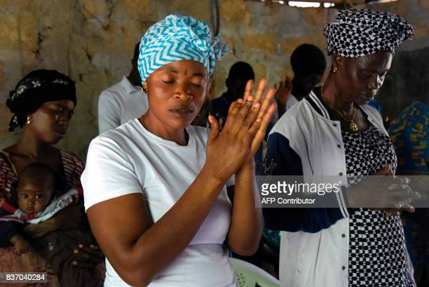 Locals attend a mass celebrated in the 'Royal Kings International' school in Freetown on August 20 2017 A week after Sierra Leone's capital Freetown...