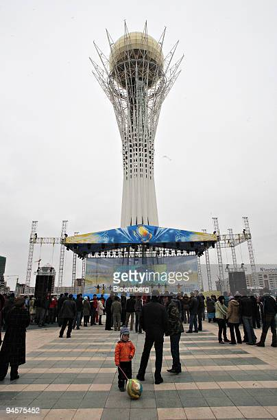 Locals attend a public concert at the base of the Bayterek tower in Astana Kazakhstan on Thursday Oct 25 2007 Astana became the capital city of...