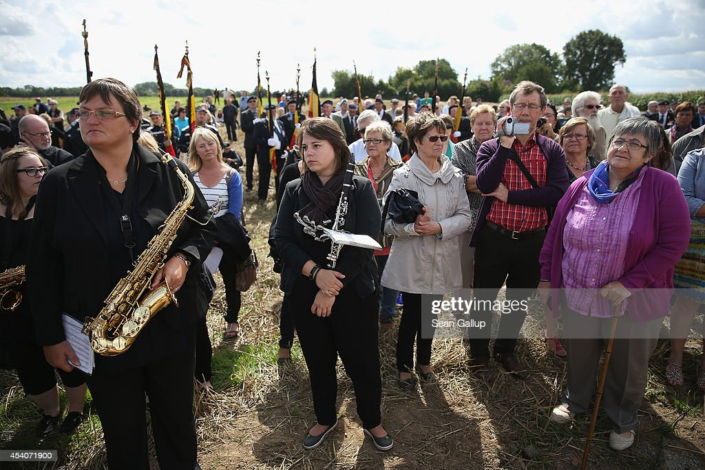 Locals attend the inauguration ceremony of a monument to honour members of the British Cheshire Regiment and other soldiers who died fighting the German Army exactly 100 years before at the same site during World War I on August 24, 2014 in Audregnies, Belgium. Of the 25 officers and 925 men of the 1st Battalion, Cheshire Regiment who fought that day on August 24, 1914, only a total of 207 would survive after two messengers with instructions for the unit to retreat failed to make it through. The battle came on the heals of the Battle of Mons the day before, which was the first major engagmement between British and German forces in the war. The British, French and Belgian armies were forced to continue their retreat until weeks later, when only a short distance from Paris they managed to reverse the tide of the war and push the Germans back north.