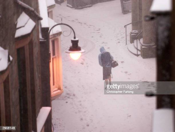 Locals brave blizzards and arctic conditions in Britain's most northerly town on January 28 2004 in Lerwick Shetland Many Scottish schools and...