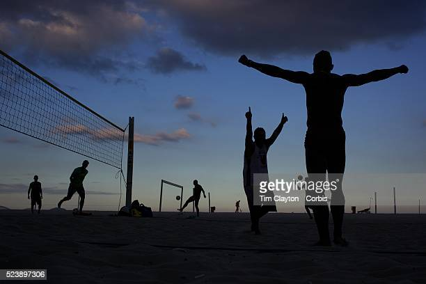Locals celebrate during a game of foot volley a hybrid game combining beach volley ball and football at Copacabana Beach Rio de Janeiro Brazil 5th...