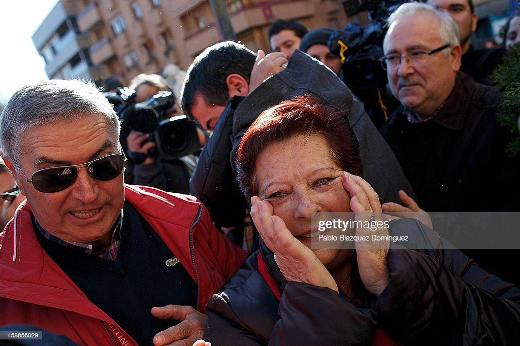 Locals celebrate next to the local lottery administration which sold the first prize tickets in Spain's Christmas lottery, 'El Gordo' (Fat One) on December 22, 2013 in Leganes, near Madrid, Spain. This year's winning number is 62246, with a total of 4 million euros for the top prize to be shared between ten ticket holders. The total prize fund is worth 2.5bn.