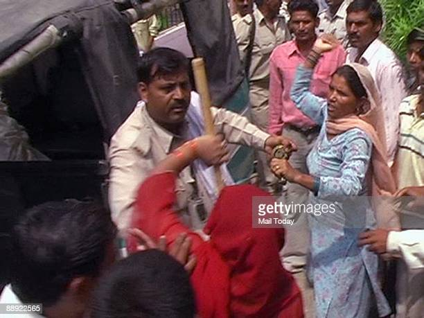Locals clash with the police in Muzaffarnagar on Wednesday July 8 2009 after a Dalit man Rajbal was allegedly tortured and killed in police custody...