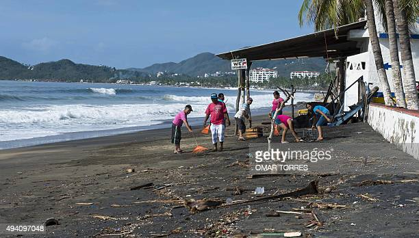 Locals clean debris at a beach restaurant in the outskirts of Manzanillo state of Colima after Hurricane Patricia hit the shore of neighbouring...