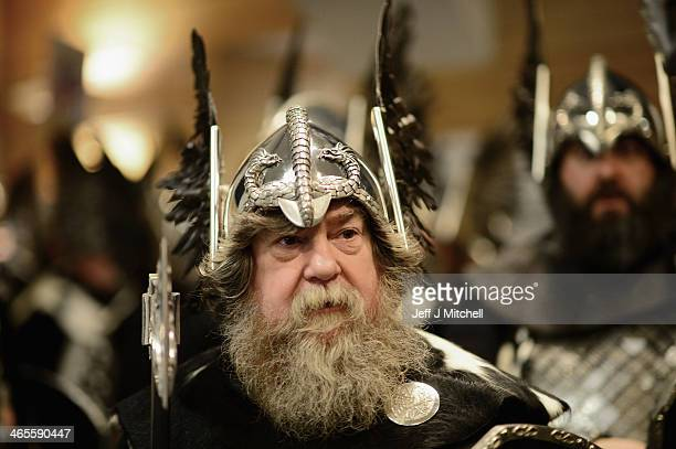 Locals dressed as Vikings visit the British Legion as they march through the streets of Lerwick on January 28 in the Shetland Islands Scotland The...