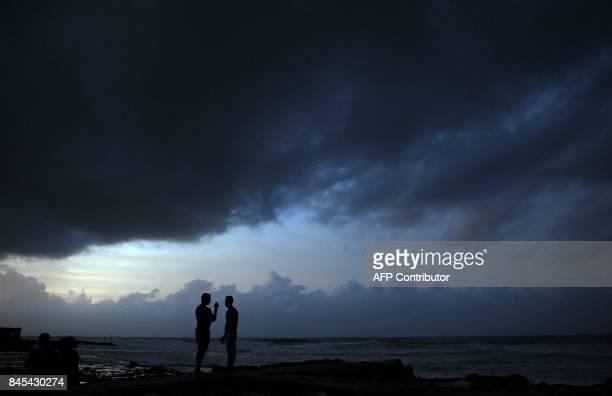 Locals enjoy sunset after the passage of Hurricane Irma in Cojimar neighborhood in Havana on September 10 2017 Residents of Cuba's historic capital...