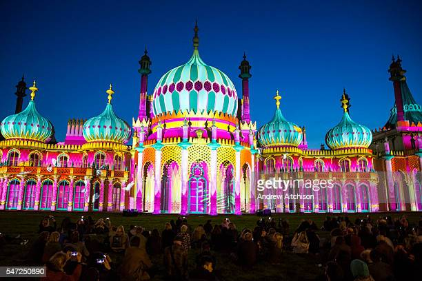 Locals enjoying Brighton Royal Pavilion lit up for the Brighton festival 2016 by Dr Blighty projections on the 25th of May 2016 in Brighton United...
