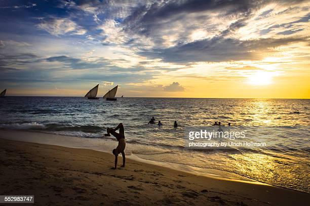 Locals enjoying sunset at Beach in Zanzibar